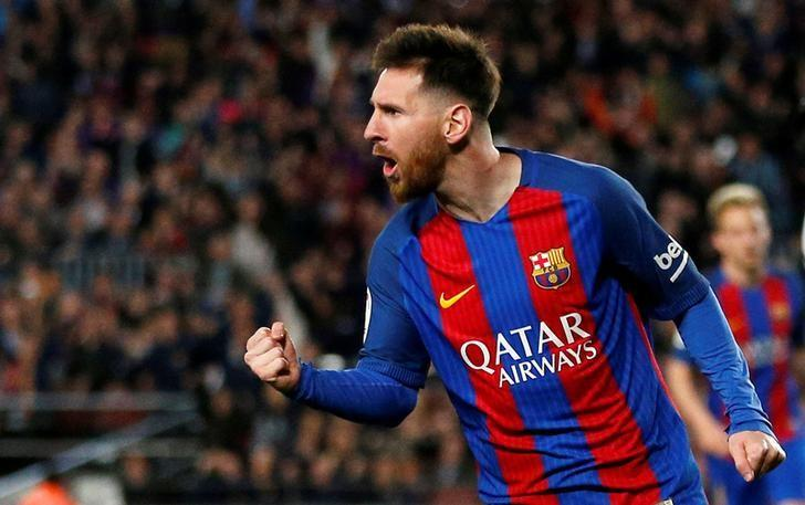 Football Soccer - Barcelona v Valencia - Spanish La Liga Santander - Camp Nou stadium, Barcelona, Spain - 19/3/17 - Barcelona's Lionel Messi celebrates his second goal. REUTERS/Juan Medina