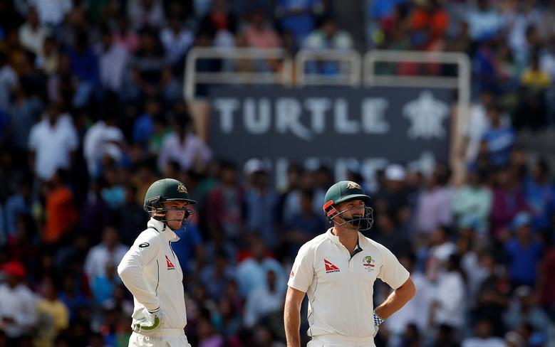 Cricket - India v Australia - Third Test cricket match - Jharkhand State Cricket Association Stadium, Ranchi, India - 20/03/17 - Australia's Peter Handscomb and Shaun Marsh (R) wait for the third umpire's decision. REUTERS/Adnan Abidi