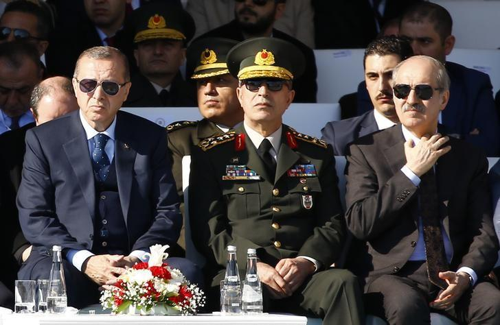 Turkish President Tayyip Erdogan, accompanied by Chief of Staff General Hulusi Akar and Deputy Prime Minister Numan Kurtulmus, attends a ceremony marking the 102nd anniversary of Battle of Canakkale, also known as the Gallipoli Campaign, at Turkish memorial in Canakkale, Turkey, March 18, 2017. REUTERS/Osman Orsal