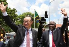 Jim Yong Kim (L), World Bank President, and Tanzania's President John Magufuli wave during the laying foundation stone for Ubungo overpass construction at the Dar es Salaam Business city in Tanzania, March 20, 2017. REUTERS/Emmanuel Herman