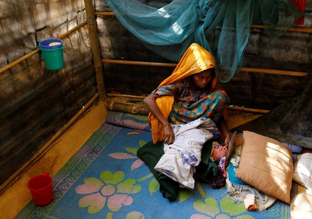 Fatema, 25, sits beside her one-day-old daughter Aasma in Kutupalang unregistered refugee camp in Cox's Bazar, Bangladesh, February 9, 2017. REUTERS/Mohammad Ponir Hossain