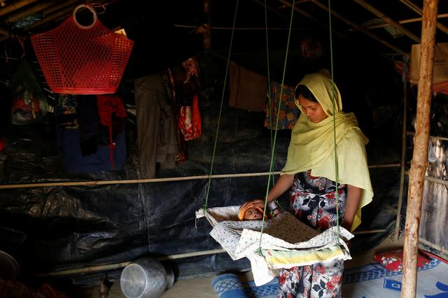 Aarafa Begum, 20, tends to her two-month-old daughter Noor Kayes, who has been suffering from fever in Kutupalang unregistered refugee camp in Cox's Bazar, Bangladesh, February 12, 2017. REUTERS/Mohammad Ponir Hossain