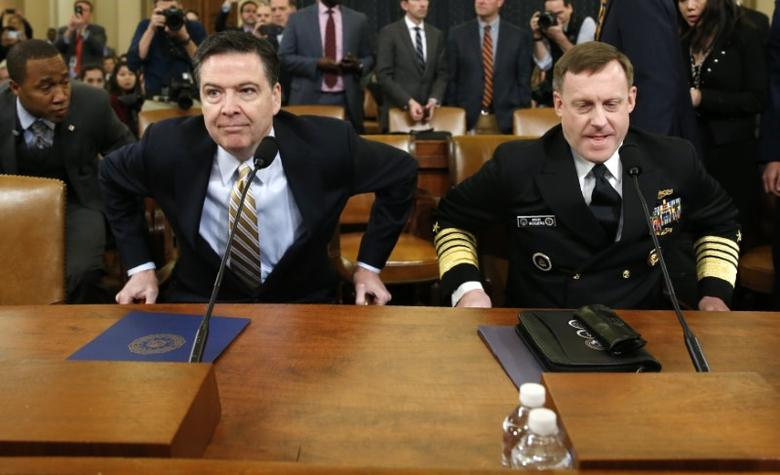 FILE PHOTO: FBI Director James Comey (L) and National Security Agency Director Mike Rogers take their seats at a House Intelligence Committee hearing into alleged Russian meddling in the 2016 U.S. election, on Capitol Hill in Washington, U.S., March 20, 2017. REUTERS/Joshua Roberts