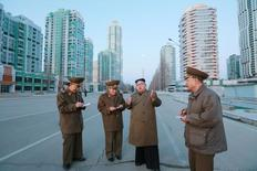 North Korean leader Kim Jong Un provides field guidance at the construction site of Ryomyong Street in this undated picture provided by KCNA in Pyongyang on March 16, 2017. KCNA/via Reuters