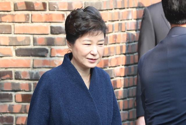 South Korea's ousted leader Park Geun-hye leaves from her private home as she heads to the prosecutors' office to be questioned over a widening corruption scandal in Seoul, South Korea, March 21, 2017. Lee Sang-Hak/Yonhap via REUTERS