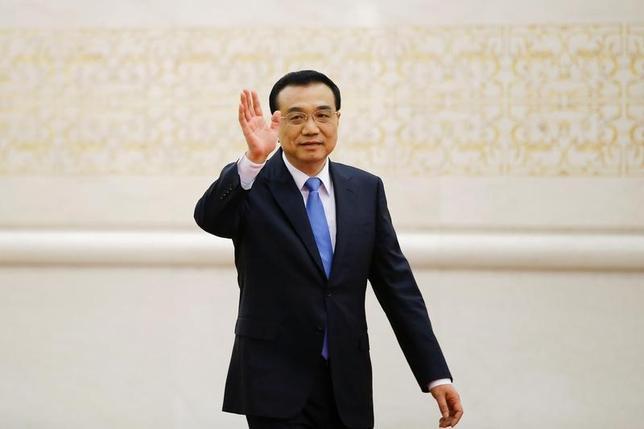 3月21日、中国は、政府が掲げるシルクロード経済圏構想「一帯一路」について、今週予定される李克強首相の豪州訪問の際に、同国の参加に向けた前向きな動きを期待しているが、関係筋によると、オーストラリアは様子見姿勢を維持し、時間を稼ぐとみられている。写真は北京で15日撮影(2017年 ロイター/Damir Sagolj)