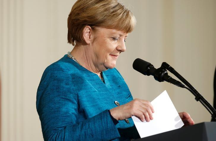German Chancellor Angela Merkel sorts her notes during a joint news conference with U.S. President Donald Trump in the East Room of the White House in Washington, U.S., March 17, 2017. REUTERS/Joshua Roberts/Files