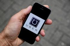 FILE PHOTO: The Uber app logo is seen on a mobile telephone in this October 28, 2016 photo illustration. REUTERS/Toby Melville/Illustration/File Photo