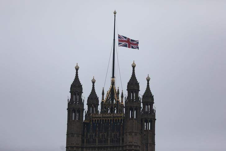 A union flag flies over Parliament at half-mast the morning after an attack by a man driving a car and weilding a knife left five people dead and dozens injured, in London, Britain, March 23, 2017.    REUTERS/Neil Hall