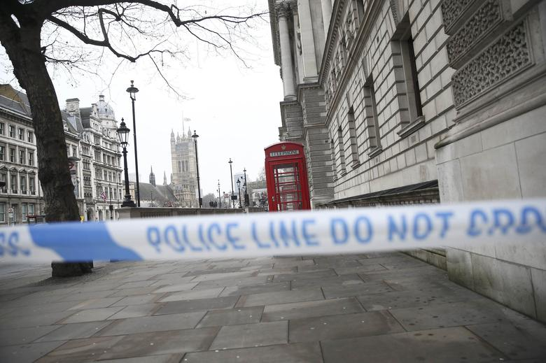 Police tape blocks access to Parliament Square the morning after an attack by a man driving a car and weilding a knife left five people dead and dozens injured, in London, Britain, March 23, 2017. REUTERS/Neil Hall