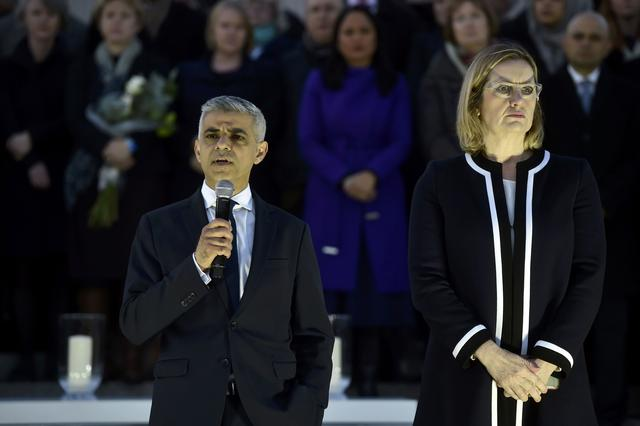 Britain's Home Secretary Amber Rudd listens as London Mayor Sadiq Khan speaks at a vigil in Trafalgar Square the day after an attack, in London, Britain March 23, 2017.    REUTERS/Hannah McKay