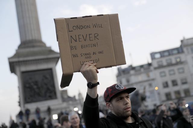 People attend a vigil in Trafalgar Square the day after an attack, in London, Britain March 23, 2017.     REUTERS/Darren Staples