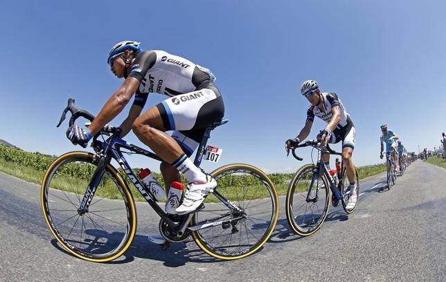 3月23日、自転車ロードレースの世界最高峰、ツール・ド・フランスを主催しているアモリー・スポーツ・オーガニゼーション(ASO)は中国市場をターゲットにしている。写真は2014年に同レースに出場した中国人選手、ジ・チェン。2014年7月撮影(2017年 ロイター/Jacky Naegelen)