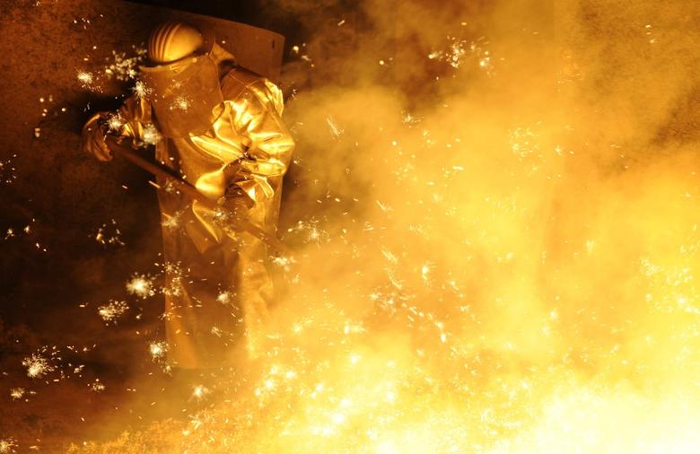 A steel-worker is pictured at a furnace at the plant of German steel company Salzgitter AG in Salzgitter, Lower Saxony late November 10, 2011. REUTERS/Fabian Bimmer