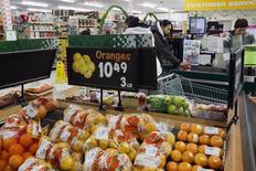 FILE PHOTO: Prices are displayed for oranges at a store in Atawapiskat, Ontario, December 17, 2011.  REUTERS/Frank Gunn/Pool