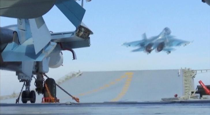 FILE PICTURE: A still image taken from a video footage and released by Russia's Defence Ministry on November 15, 2016, shows a jet taking off from Russian Admiral Kuznetsov aircraft carrier near the coast of Syria. Ministry of Defence of the Russian Federation/Handout via REUTERS TV/File Photo