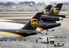 FILE PHOTO - United Parcel Service (UPS) aircraft are loaded and unloaded with air containers full of packages at the UPS Worldport All Points International Hub in Louisville, Kentucky, U.S. on December 9, 2016. REUTERS/John Sommers II/File Photo