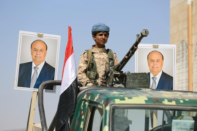 A police trooper mans a machine gun mounted on a patrol truck securing a street where people loyal to Yemen's President Abd-Rabbu Mansour Hadi demonstrated to show support to Hadi in the country's northern city of Marib November 3, 2016. REUTERS/Ali Owidha