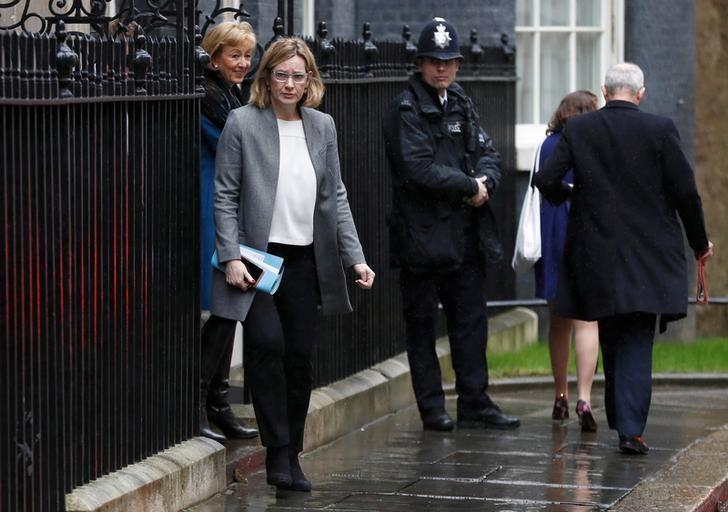 Britain's Home Secretary Amber Rudd and Secretary of State for Rural Affairs Andrea Leadson (L) leave 10 Downing Street after a cabinet meeting ahead of the budget in London, March 8, 2017. REUTERS/Stefan Wermuth