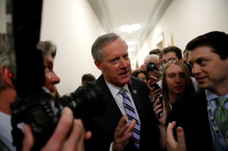 House Freedom Caucus Chairman U.S. Representative Mark Meadows (R-NC) speaks to reporters after meeting with his caucus members about their votes on a potential repeal of Obamacare on Capitol Hill in Washington, U.S., March 23, 2017. REUTERS/Jonathan Ernst
