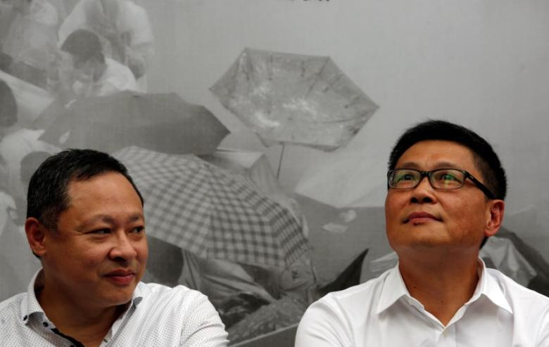 Professors Benny Tai (L) and Chan Kin-man, founders of Occupy Central civil disobedience movement, take part in the second anniversary of the movement outside the government headquarters in Hong Kong, China September 28, 2016.  REUTERS/Bobby Yip