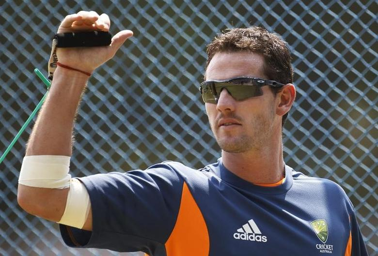 Australia's Shaun Tait performs a stretching exercise during a cricket practice session ahead of their ICC Cricket World Cup Group A match against Kenya on Sunday, in Bangalore March 11, 2011. REUTERS/Adnan Abidi