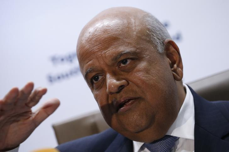 South Africa's Finance Minister, Pravin Gordhan gestures during a media briefing after he was reappointed to the position on Sunday night by President Jacob Zuma in Pretoria, South Africa December 14, 2015. REUTERS/Siphiwe Sibeko/Files