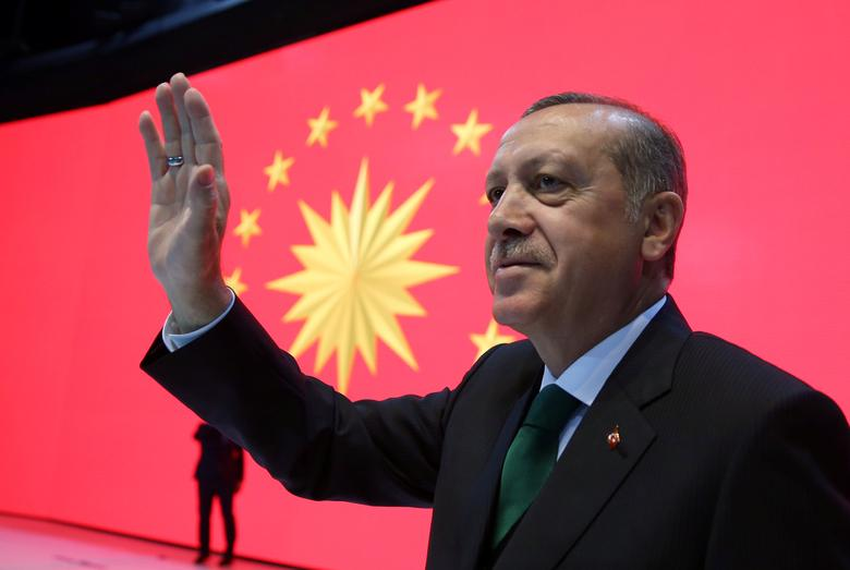 Turkish President Tayyip Erdogan greets the audience during a meeting in Istanbul, Turkey, March 27, 2017. Yasin Bulbul/Presidential Palace/Handout via REUTERS