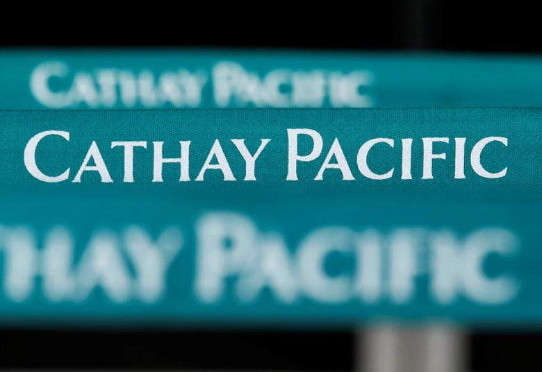 FILE PHOTO: Lined up banners are seen at a city check-in counter of Cathay Pacific Airways in downtown Hong Kong August 8, 2012.   REUTERS/Bobby Yip/File Photo