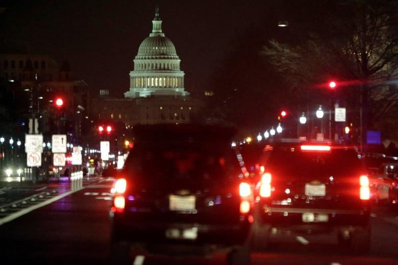 A motorcade drives along Pennsylvania Avenue as U.S. President Donald Trump goes for a dinner at Trump International Hotel in Washington, U.S., March 25, 2017. REUTERS/Yuri Gripas