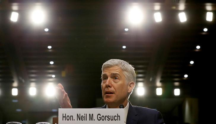 FILE PHOTO - U.S. Supreme Court nominee judge Neil Gorsuch responds to a question as he testifies during the third day of his Senate Judiciary Committee confirmation hearing on Capitol Hill in Washington, U.S. on March 22, 2017. REUTERS/Jim Bourg/File Photo