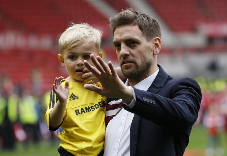 Britain Soccer Football - Middlesbrough v Brighton & Hove Albion - Sky Bet Football League Championship - The Riverside Stadium - 15/16 - 7/5/16Middlesbrough's Jonathan Woodgate celebrates promotion to the premier league with his familyAction Images via Reuters / Craig Brough