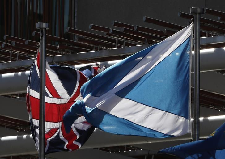 The Union flag and The Scottish Saltire fly at the Scottish Parliament ahead of a referendum debate in Edinburgh Scotland, Britain March 21, 2017. REUTERS/Russell Cheyne