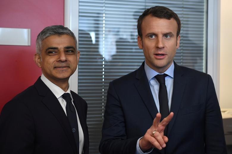 Emmanuel Macron (R), head of the political movement En Marche !, or Onwards !, and candidate for the 2017 French presidential election, meets London Mayor Sadiq Khan at his campaign headquarters in Paris, France, March 29, 2017.  REUTERS/Eric Feferberg/Pool