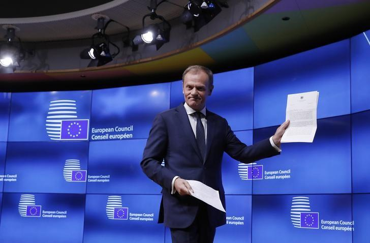 European Council President Donald Tusk leaves after a news conference after receiving British Prime Minister Theresa May's Brexit letter in notice of the UK's intention to leave the bloc under Article 50 of the EU's Lisbon Treaty to EU Council President Donald Tusk in Brussels, Belgium March 29, 2017.  REUTERS/Yves Herman