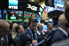 A trader wearing a Trump hat works at the New York Stock Exchange (NYSE) in Manhattan, New York City, U.S., January 20, 2017. REUTERS/Stephen Yang
