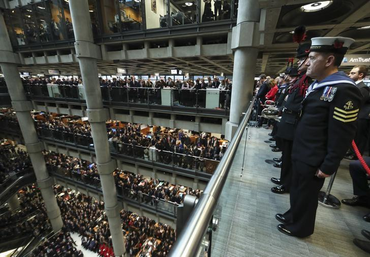 Lloyd's of London staff hold their annual Armistice Day service at the Lloyd's building in the City of London, Britain November 11, 2016.  REUTERS/Eddie Keogh/Files