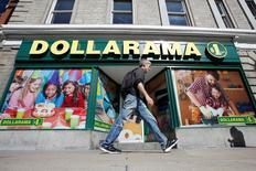 A pedestrian walks past a Dollarama store in Ottawa, Ontario, Canada, September 1, 2016. REUTERS/Chris Wattie