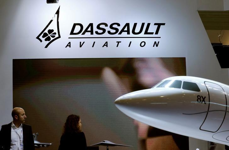 FILE PHOTO: A Dassault Aviation logo is pictured on the company booth during the European Business Aviation Convention & Exhibition (EBACE) at Cointrin airport in Geneva, Switzerland, May 24, 2016.  REUTERS/Denis Balibouse/File Photo