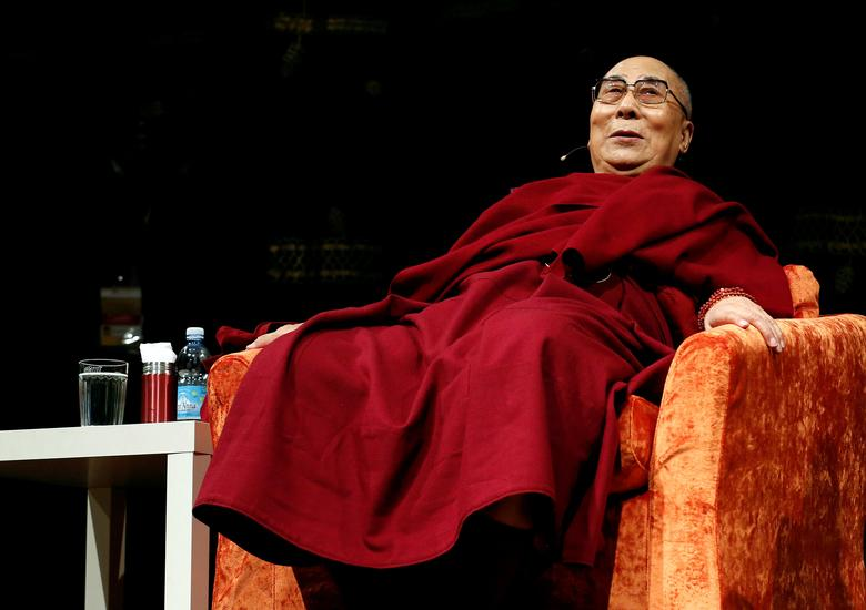 FILE PHOTO: Tibet's exiled spiritual leader the Dalai Lama is seen at the Arcimboldi theater before receiving honorary citizenship of the city of Milan, in Milan, Italy October 20, 2016. REUTERS/Stefano Rellandini/File Photo