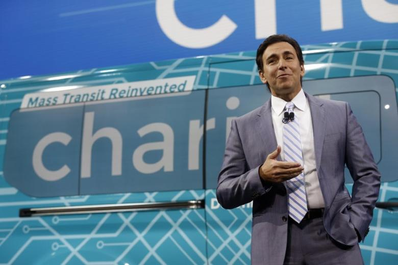 Ford president and CEO Mark Fields speaks near the logo of shuttle van startup Chariot, during the North American International Auto Show in Detroit, Michigan, U.S., January 9, 2017.  REUTERS/Rebecca Cook