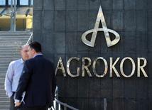 Логотип Agrokor в штаб-квартире компании в Загребе. 22 марта 2017 года. Банки-кредиторы обремененной долгами Agrokor достигли с хорватской компанией соглашения, которое должно позволить ей стабилизировать свое положение, сообщил в пятницу источник в Сбербанке. REUTERS/Antonio Bronic