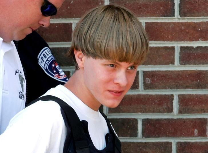 FILE PHOTO: Police lead suspected shooter Dylann Roof into the courthouse in Shelby, North Carolina, U.S. June 18, 2015.  REUTERS/Jason Miczek/File Photo