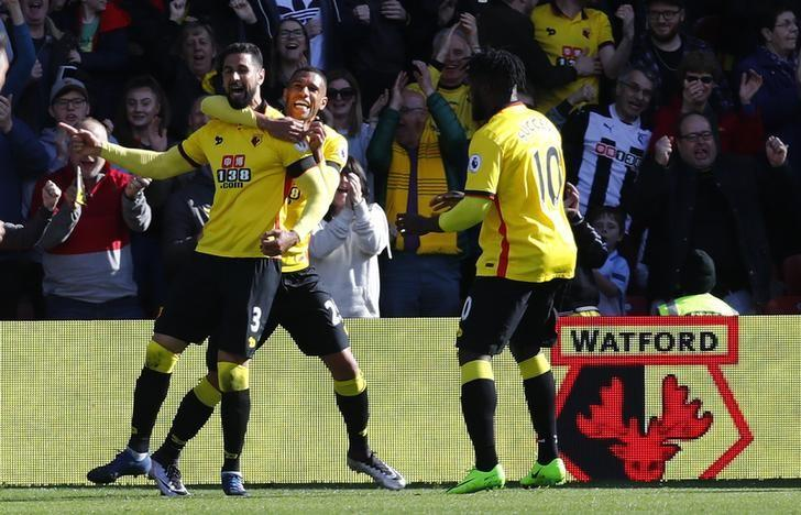 Britain Soccer Football - Watford v Sunderland - Premier League - Vicarage Road - 1/4/17 Watford's Miguel Britos celebrates scoring their first goal with Watford's Etienne Capoue and Watford's Isaac Success  Reuters / Eddie Keogh Livepic
