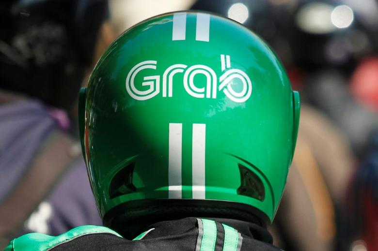 The helmet of a Grab bike rider is seen during rush hour traffic in Jakarta, Indonesia, July 18, 2016. REUTERS/Iqro Rinaldi