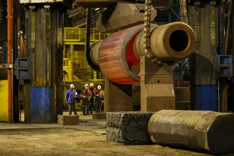 Workmen are seen in the foundry at the Areva Creusot Forge site in Le Creusot, France, January 11, 2017.   REUTERS/Robert Pratta
