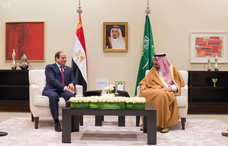 Saudi Arabia's King Salman bin Abdulaziz Al Saud (R) meets with Egypt's President Abdel Fattah al-Sisi on the sideline of the 28th Ordinary Summit of the Arab League at the Dead Sea, Jordan March 29, 2017. Saudi Press Agency/Handout via REUTERS