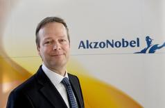 Ton Buchner, CEO of AkzoNobel, poses during a photocall at the presentation of the 2013 full-year results in Amsterdam February 6, 2014. REUTERS/Toussaint Kluiters/United Photos
