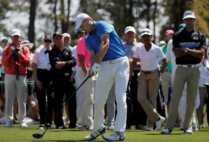 Masters champion Jordan Spieth is watched by Bubba Watson, Gary Player and Condoleezza Rice as starts a practice round on the first tee at Augusta National Golf Course in Augusta, Georgia, U.S., April 2, 2017.  REUTERS/Brian Snyder