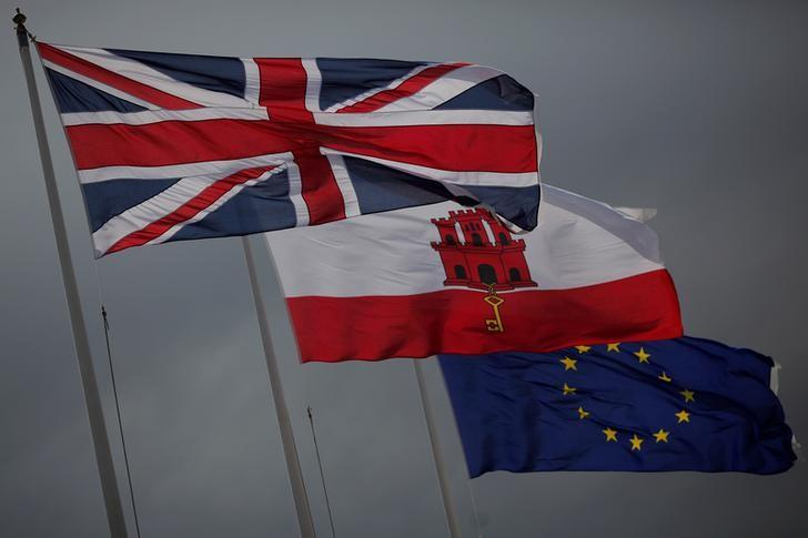 The Union Jack (L), the Gibraltarian flag (C) and the European Union flag are seen flying at the border of Gibraltar with Spain, in the British overseas territory of Gibraltar, historically claimed by Spain April 3, 2017. REUTERS/Jon Nazca